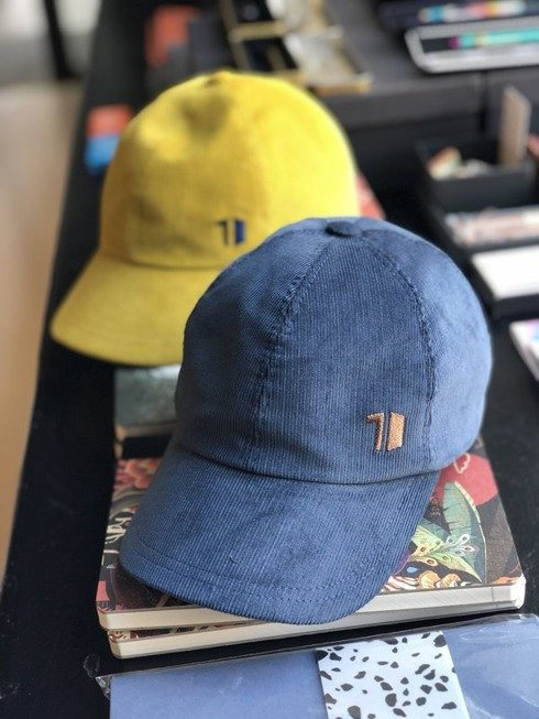 """corduroy baseball caps for our anniversary """"10""""."""